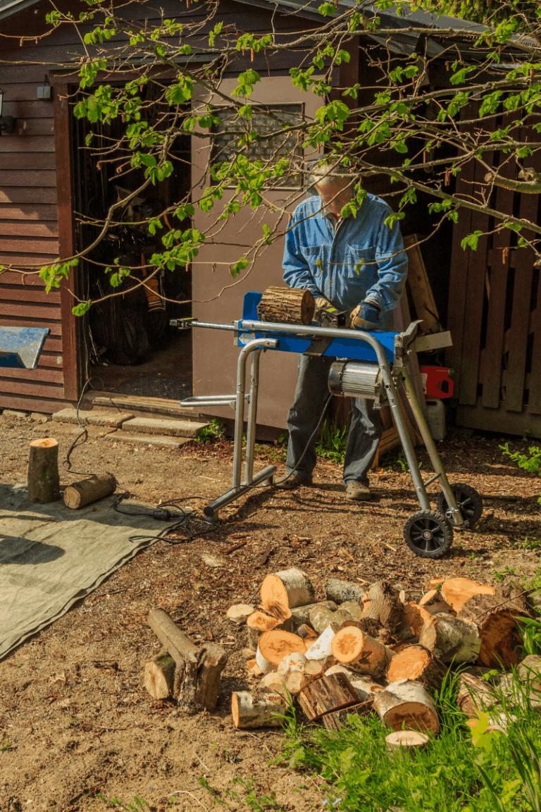 man using electric log splitter to split fire wood