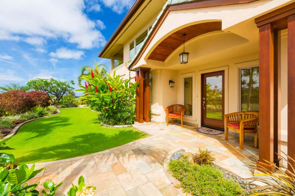 Beautiful Home Exterior front door with stone sidewalk and landscaping